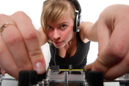 Teenager chick regulating sound on professional audio mixer photo