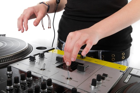 Girl DJ playing hip-hop music from vinyl records photo