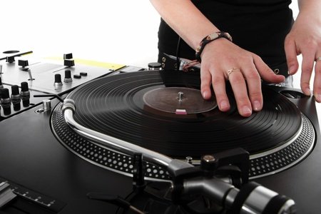 scratching: Girl DJ playing hip-hop music on turntables