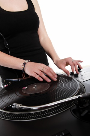 Hands of a disc jockey girl mixing music photo