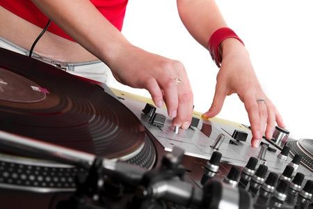 regulators: Girl disc jockey adjusting the sound levels on professional mixing controller Stock Photo