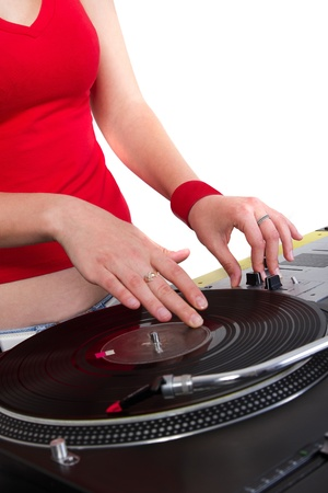 Girl playing music on professional Dj equipment photo