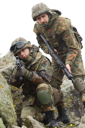 Two soldiers in heavy combative ammunition photo