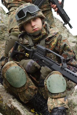Two soldiers in heavy combative ammunition Stock Photo - 9534778