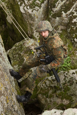 combative: Military man does dangerous rappeling in combative ammunition