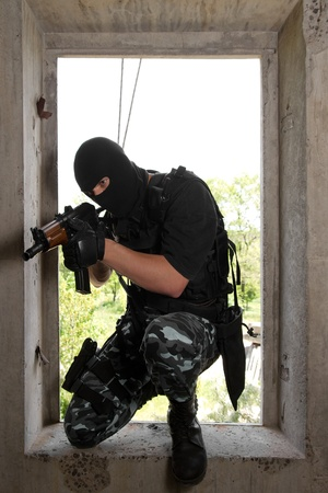 armed forces: Photo of armed man in combat uniform playing terrorist or special forces team member