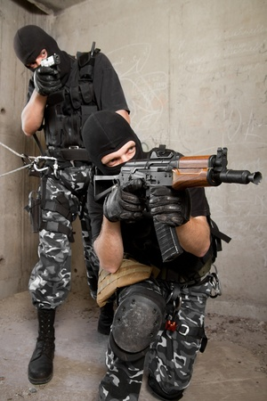 Photo of armed men in combat uniform playing terrorist or special forces team members Stock Photo - 9790238