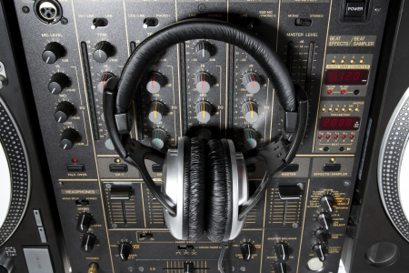 Professional DJ stereo headset on mixing controller photo