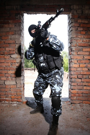 airsoft gun: Fully equipped military men with automatic weapons playing strikeball