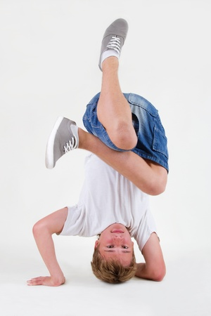 Teenager bboy training on white background photo