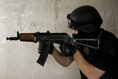 Photo of armed man in combat uniform playing terrorist or special forces team member photo