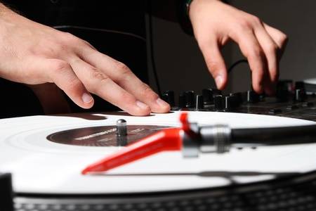 regulators: Disc jockey mixing music on professional audio equipment