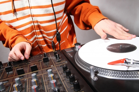 Disc jockey playing hip-hop music on professional top-class club equipment photo