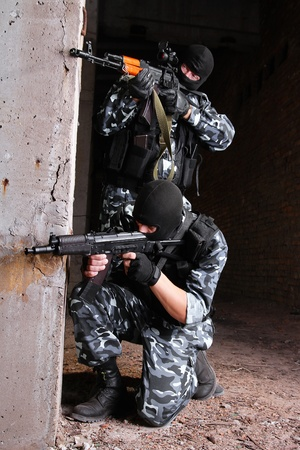military uniform: Photos of heavy equiped soldiers or terrorists in black masks with automatic guns.