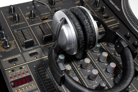regulators: Professional DJ stereo headset on mixing controller