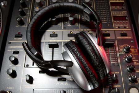 deejay: Professional DJ stereo headset on mixing controller