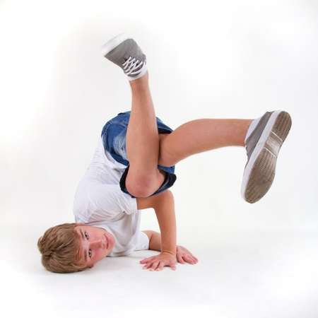 Young break dancer standing in freeze looking into the camera. Photo in square format Stock Photo - 12450446