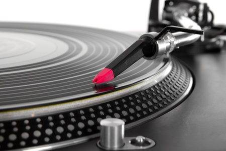 Professional audio equipment for disc jockey - turntable record player with high-class spherical needle. Closeup shot of tonearm on the vinyl disc. photo