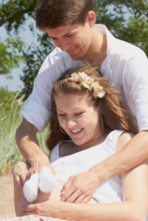 This young couple is happily waiting for their first child to be born  soon Stock Photo - 14072967