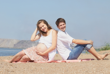 This young couple is happily waiting for their first child to be born  soon photo