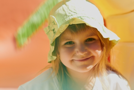 Pretty young girl posing outdoors in a bright sunny day with beautiful smile Stock Photo - 14243765
