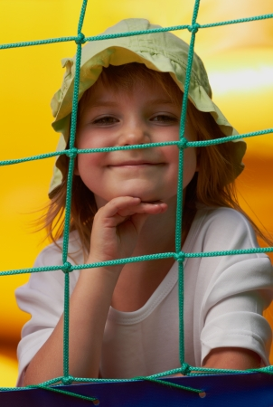 Pretty young girl posing in a bouncing castle in a bright sunny day with beautiful smile photo