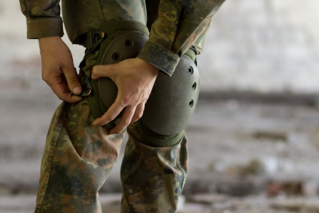kneepad: Soldier preparing his ammunition before operation