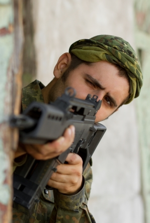 Soldier with automatic G36 rifle aiming his target Stock Photo - 14633137