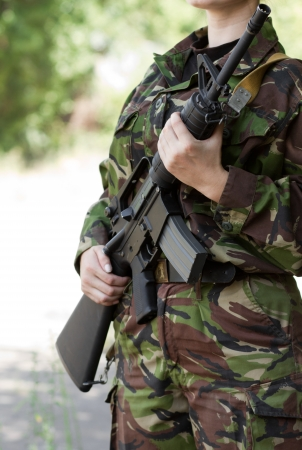 Female soldier ready to serve and protect photo