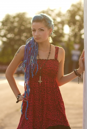 Pretty punk girl with attitude looking at you photo