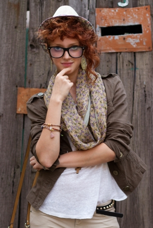 Stylish young hipster chick posing outdoors Stock Photo