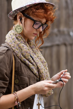 Searching for her favourite music in her mobile phone Stock Photo