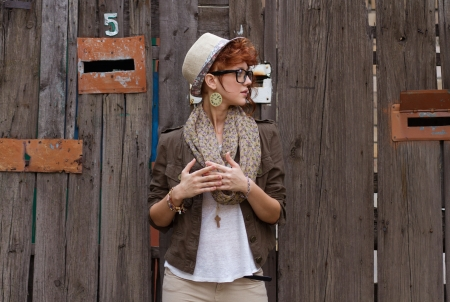Fashionable young person in vintage hat and eyeglasses photo