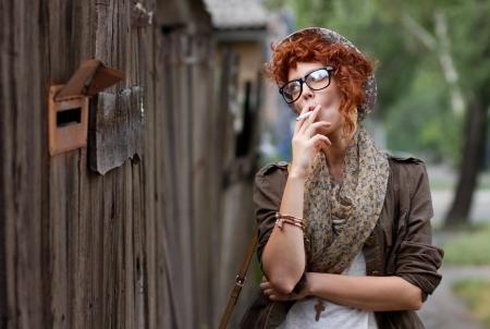 Cigarettes come with sad mood, she knows it photo