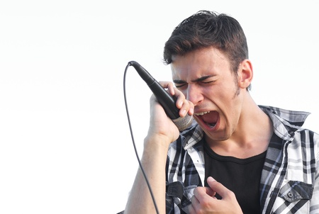 overexposed: Young rocker singing expressive. Isolated on overexposed white sky outdoors