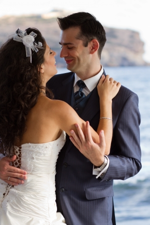 newlywed: First wedding dance with crystal blue sea on the background Stock Photo