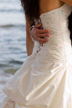 First wedding dance with crystal blue sea on the background Stock Photo