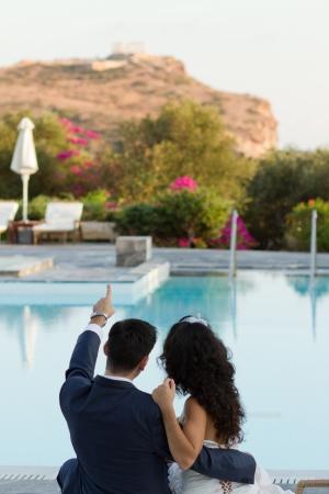 Groom shows his fiancee Temple of Poseidon in Cape Sounio, Attiki region resort near Athens Stock Photo - 15980666