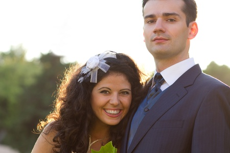 Smiling young couple posing after their wedding Stock Photo - 15980673