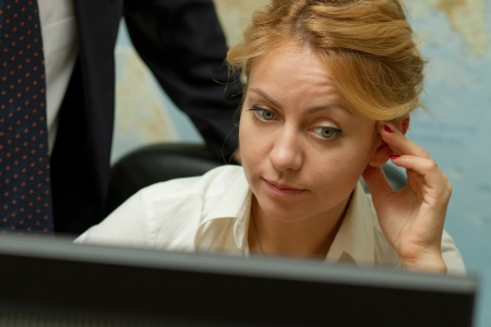 Attractive blond secretary listening carefully to the new task from her chief Stock Photo - 16016427