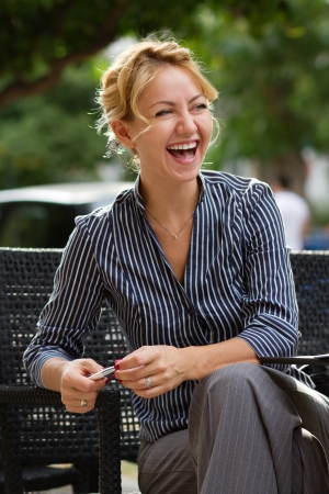 Young attractive businesswoman laughing out loud photo