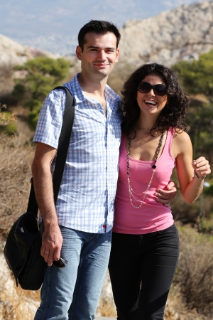 Young happy couple do sightseeing in Greek capital - city of Athens in a bright sunny day Stock Photo - 16830024