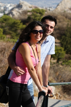 Young happy couple do sightseeing in Greek capital - city of Athens in a bright sunny day Stock Photo - 16830019