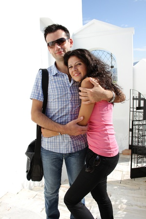 Young happy couple do sightseeing in Greek capital - city of Athens in a bright sunny day Stock Photo - 16830033