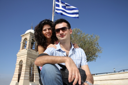 Young happy couple do sightseeing in Greek capital - city of Athens in a bright sunny day Stock Photo - 16854901