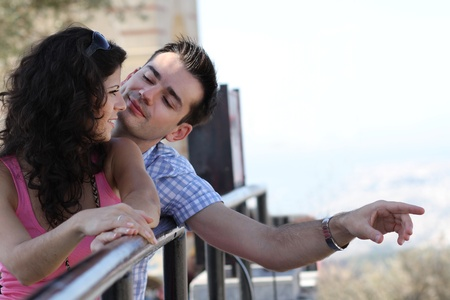 Young happy couple do sightseeing in Greek capital - city of Athens in a bright sunny day Stock Photo - 16830021