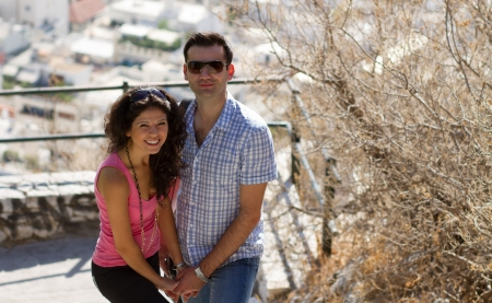 Young happy couple do sightseeing in Greek capital - city of Athens in a bright sunny day Stock Photo - 16830022