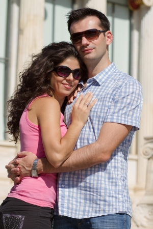Young happy couple do sightseeing in Greek capital - city of Athens in a bright sunny day Stock Photo - 16830041