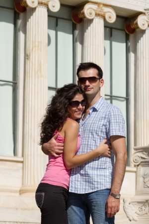 Young happy couple do sightseeing in Greek capital - city of Athens in a bright sunny day Stock Photo - 16830020