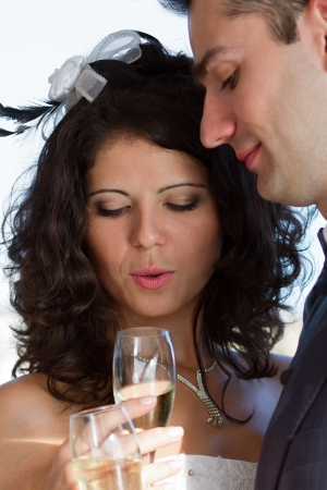 Happy young couple drinking their wedding champagne photo